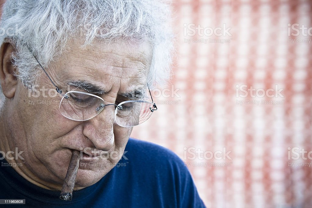 Smoking wise man royalty-free stock photo