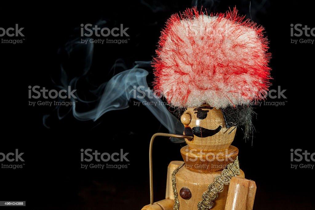 smoking wooden man stock photo