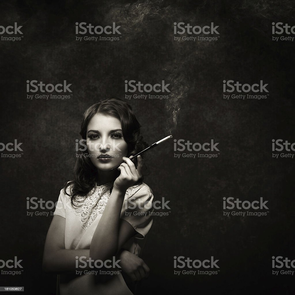 smoking young woman - vintage style royalty-free stock photo