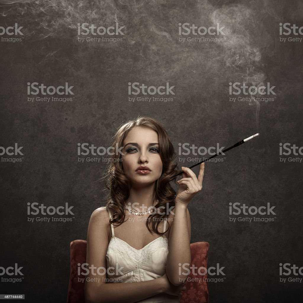 smoking young woman - vintage style stock photo