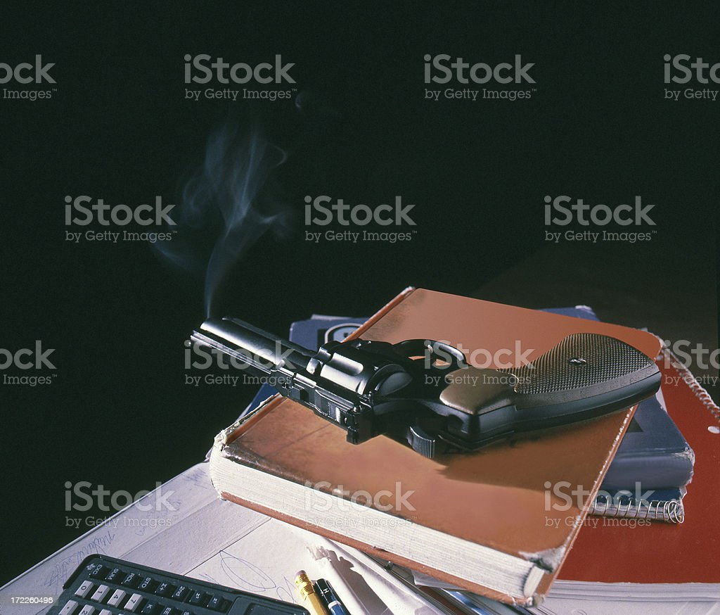 Smoking-Gun with School Books royalty-free stock photo