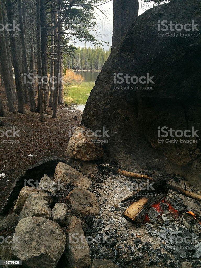 Smoldering Campfire at a Lake royalty-free stock photo