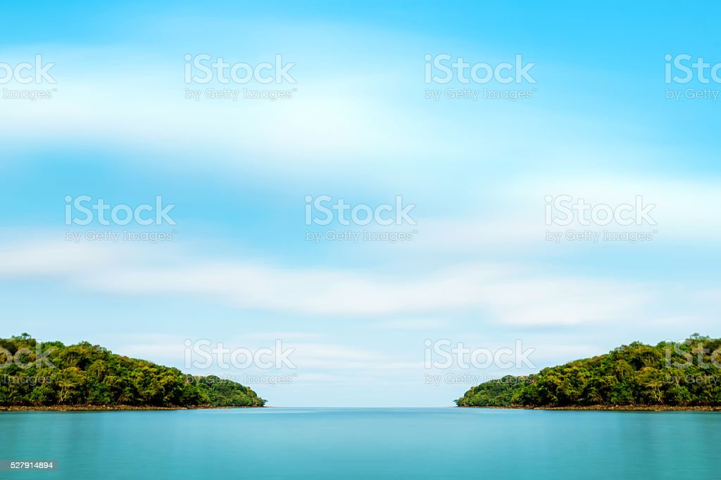 Smooth cloud at the ocean stock photo
