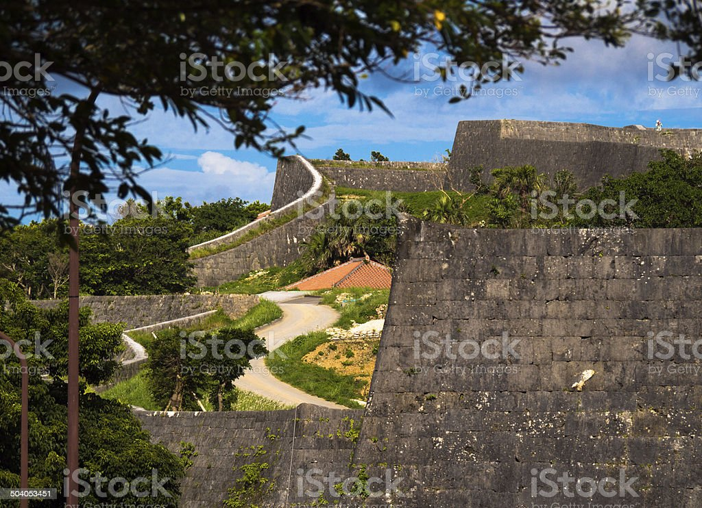 Smooth curve rampart and blue sky, Okinawa, July, 1st, 2013 stock photo