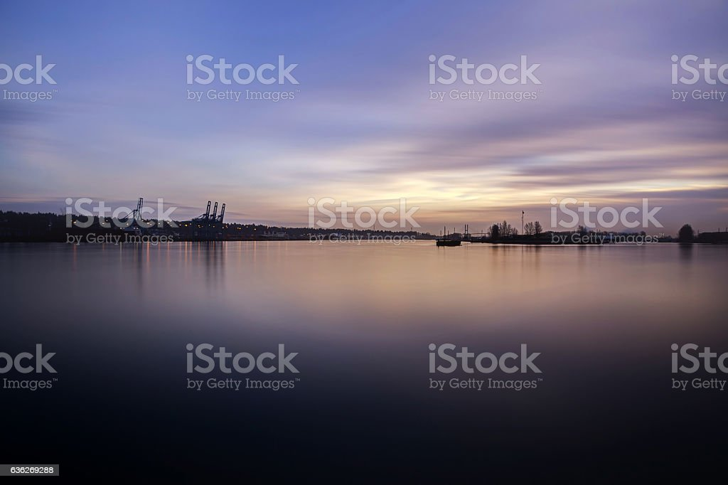 smooth effect of clouds and river water at sunset stock photo