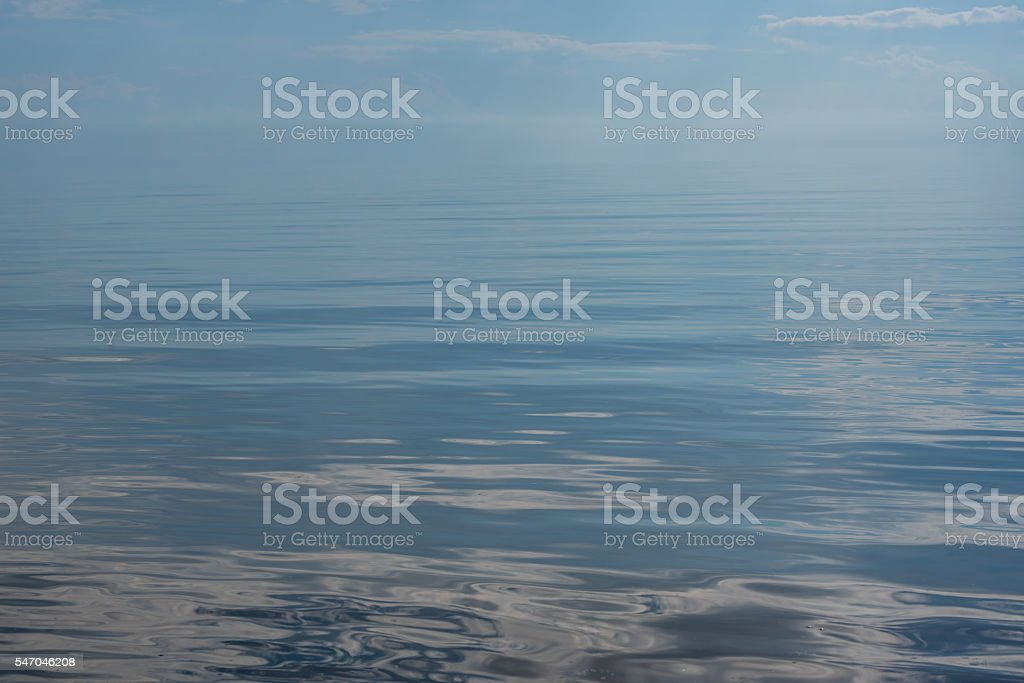 Smooth Glass LIke Sea with Clouds Reflected stock photo