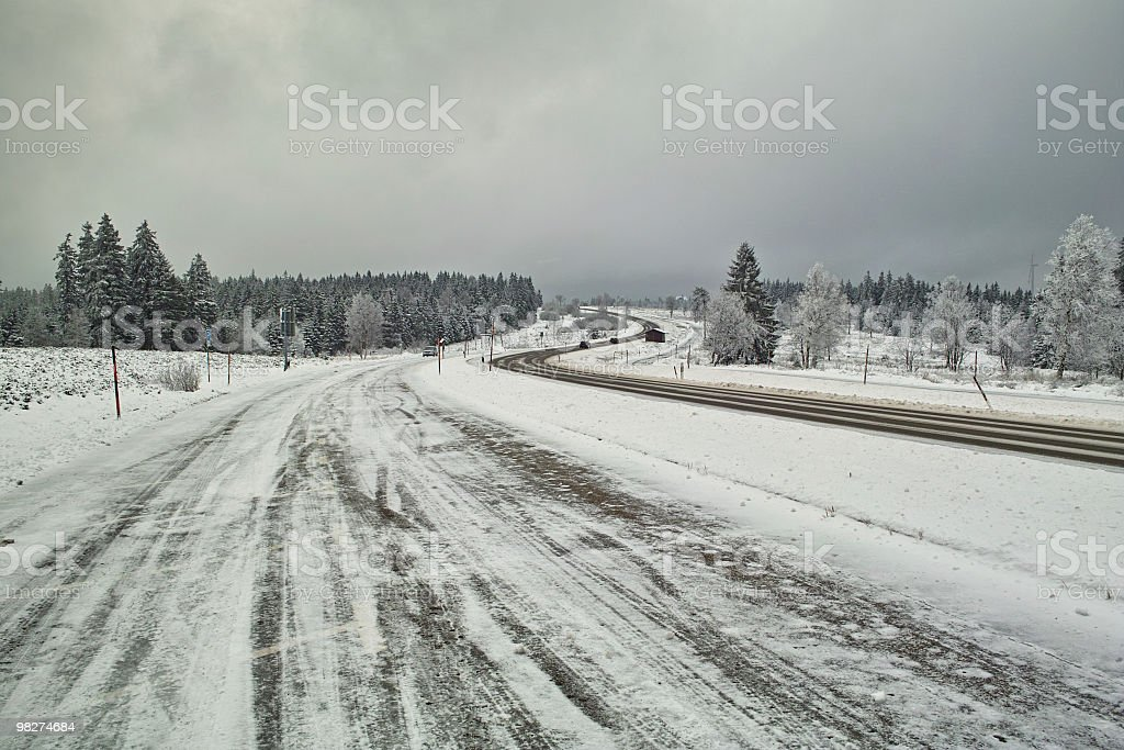 smooth icy snow covered and street in winter time stock photo