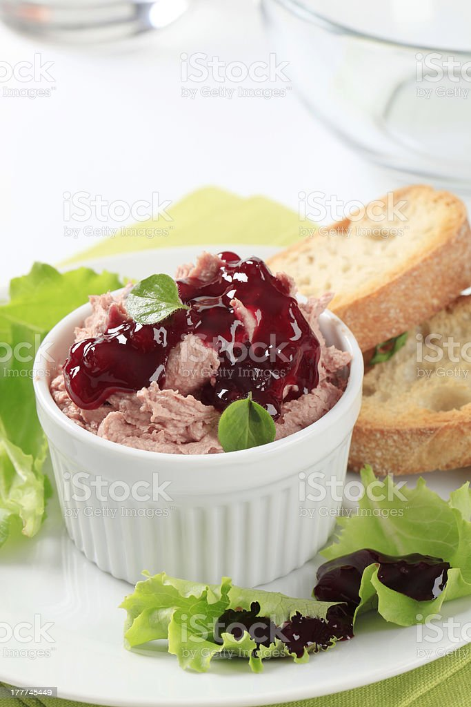 Smooth pate with cranberry sauce stock photo