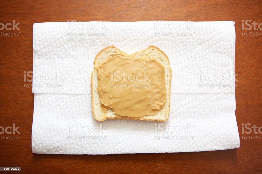 smooth peanut butter on bread stock photo