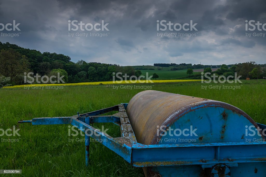 Smooth roller in s field in the sunlight stock photo