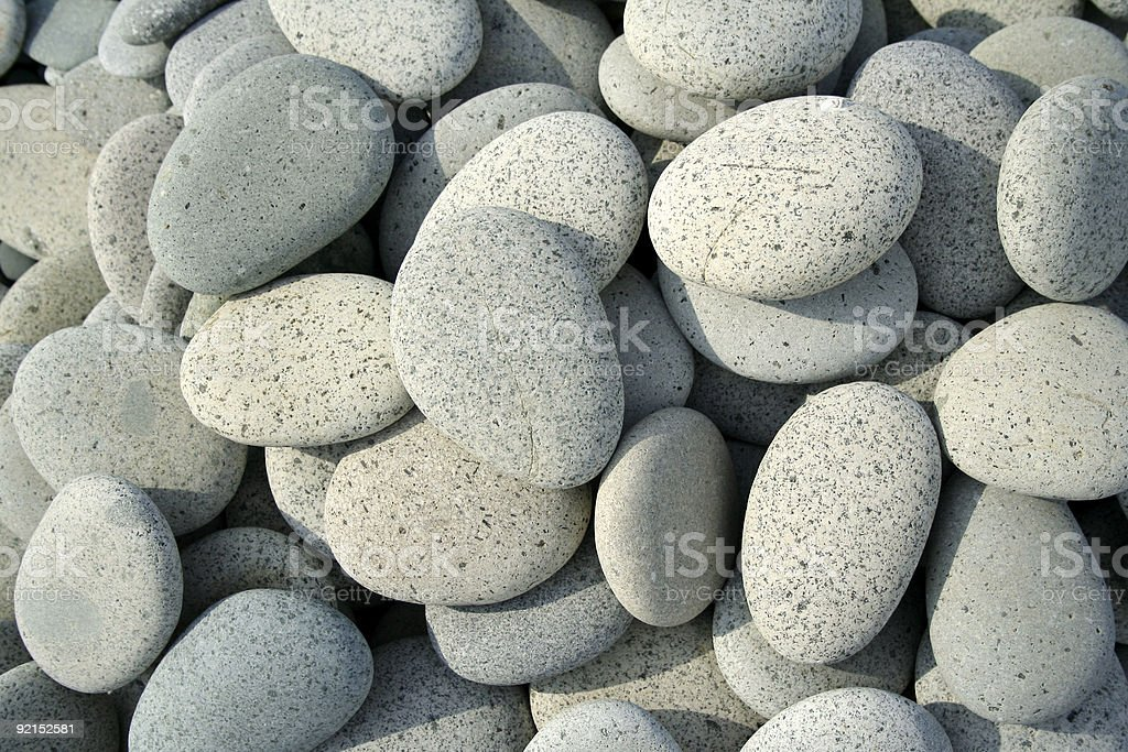 smooth stones and pebbles background royalty-free stock photo