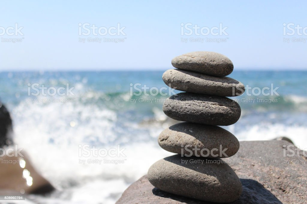 Smooth Stones Stacked on Greek Island Beach stock photo