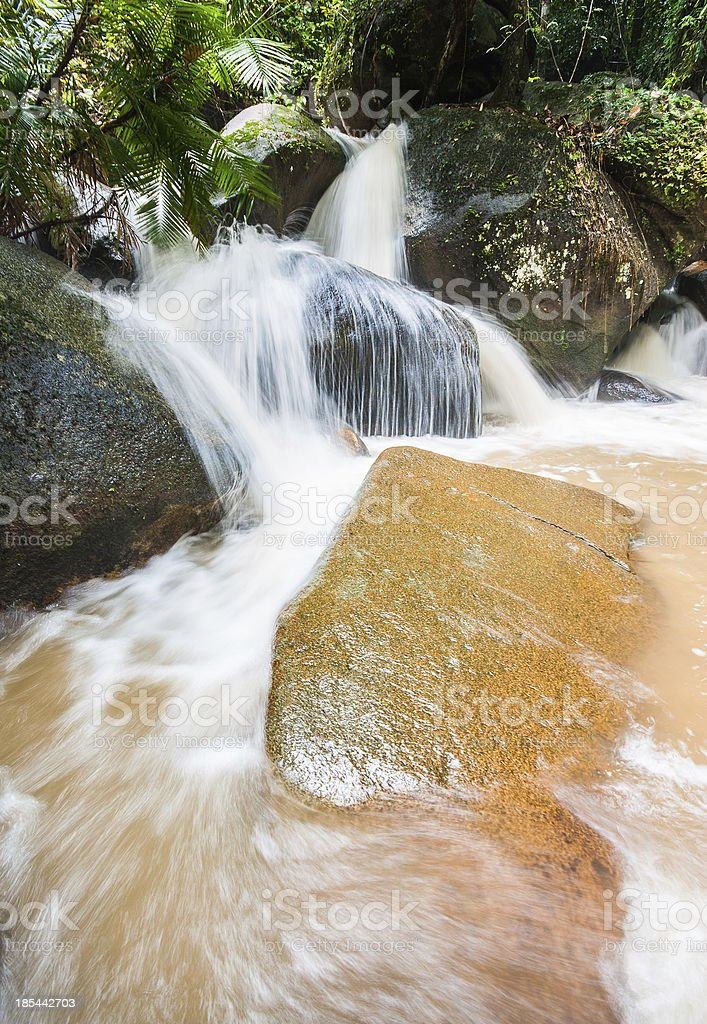 smooth waterfall in forest after heavy rain royalty-free stock photo