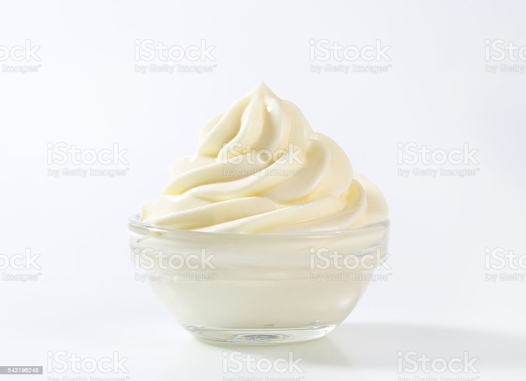 Smooth white cream in a bowl stock photo