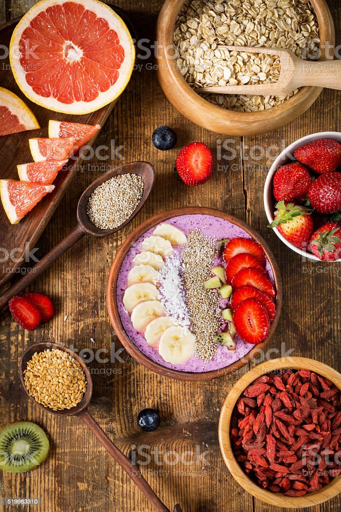 Smoothie bowl with fruits, berries and various superfoods stock photo