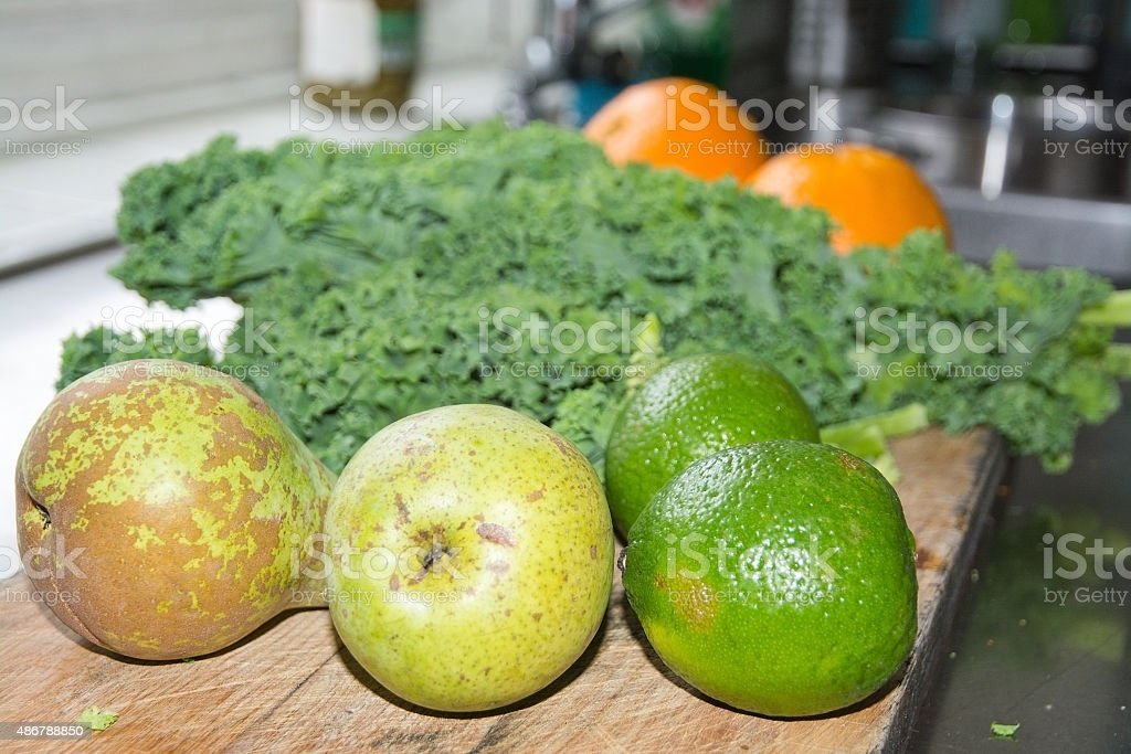 Smoothie ingredients kale pears lime oranges stock photo