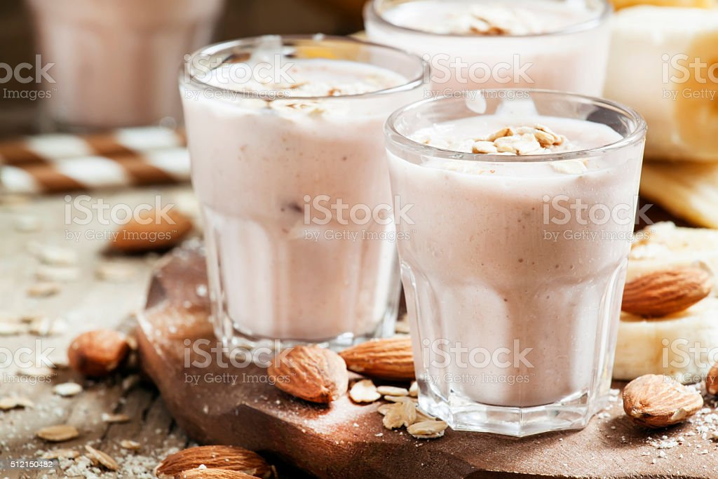Smoothie with banana, yogurt, oatmeal and nuts stock photo