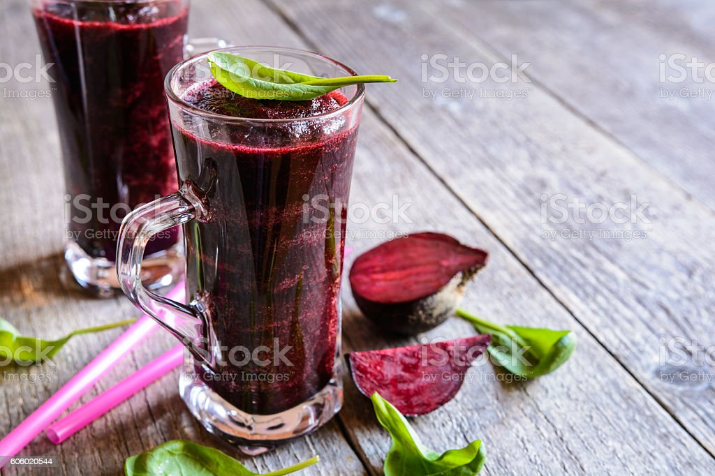 Smoothie with beetroot, spinach and lemon stock photo