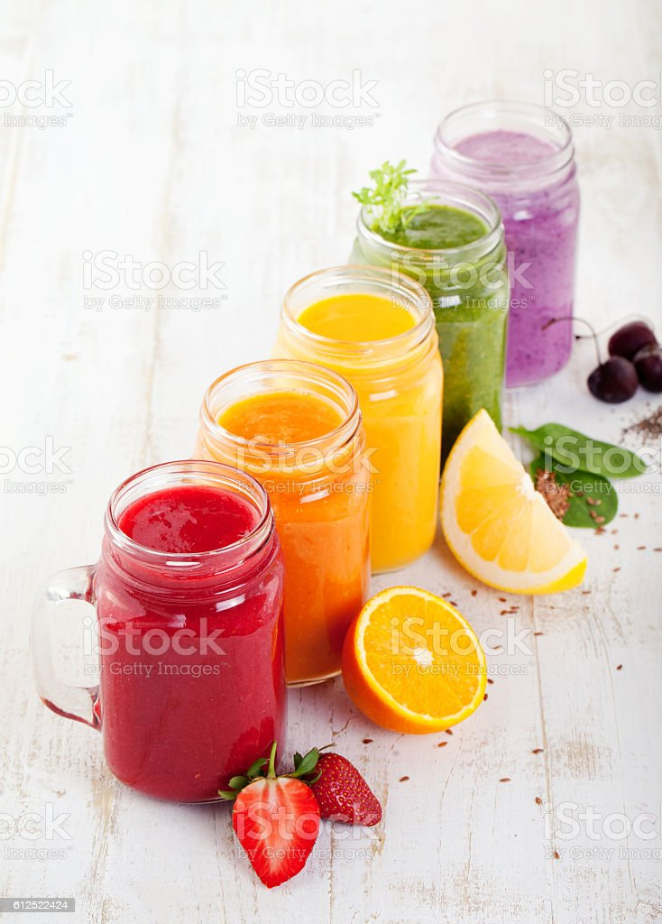 Smoothies, juices, beverages, drinks variety stock photo