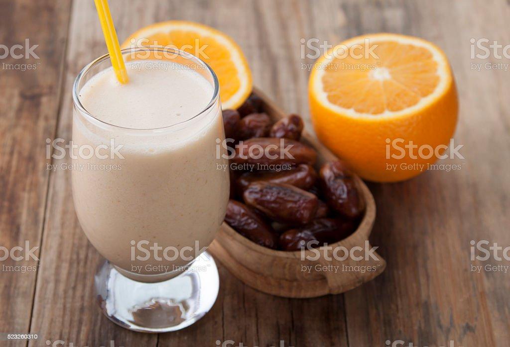 Smoothies of orange and dates . stock photo