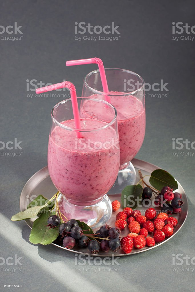 Smoothies of strawberry and shadberry with yogurt. stock photo