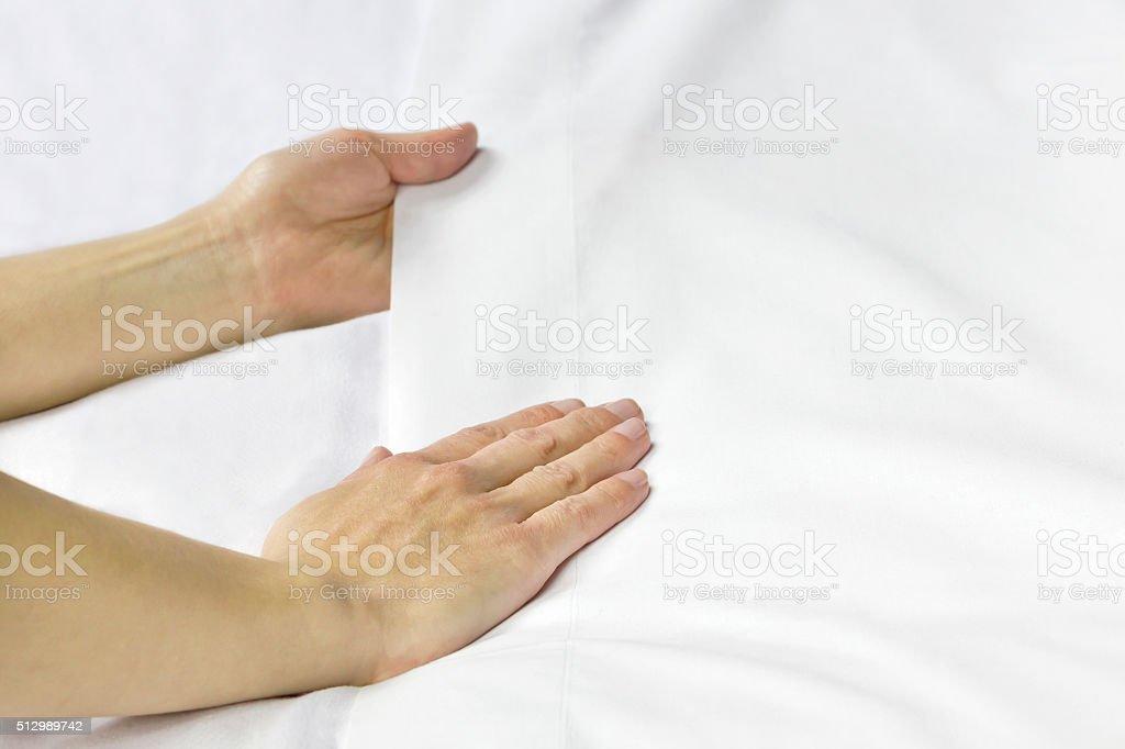 Smoothing bed sheet stock photo