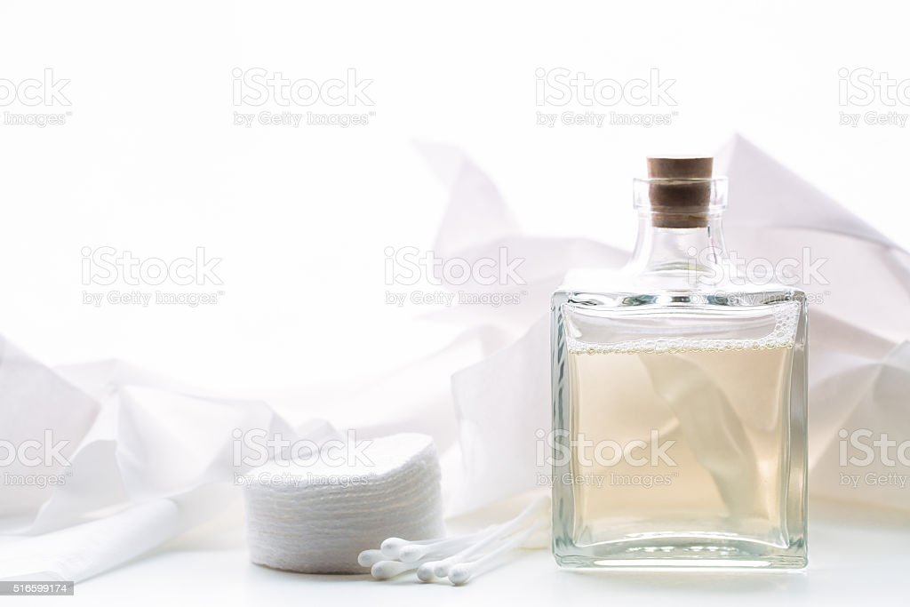 Smoothing lotion and cotton pads stock photo