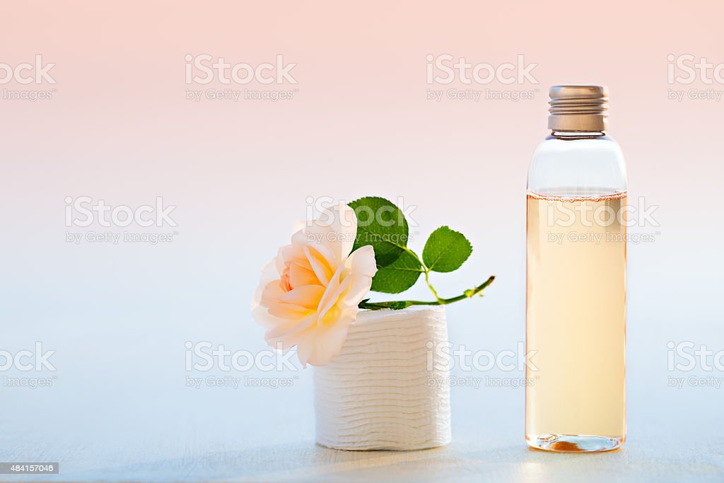 Smoothing toner and cotton pads stock photo