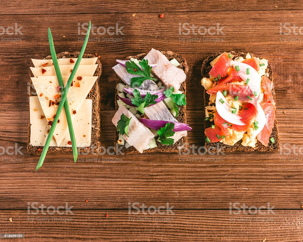 Smorrebrod - danish open sandwich with fish, herring, cheese stock photo
