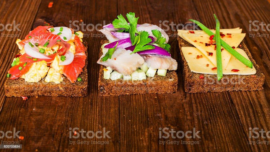 Smorrebrod - danish open sandwich with fish, herring, cheese stock photo