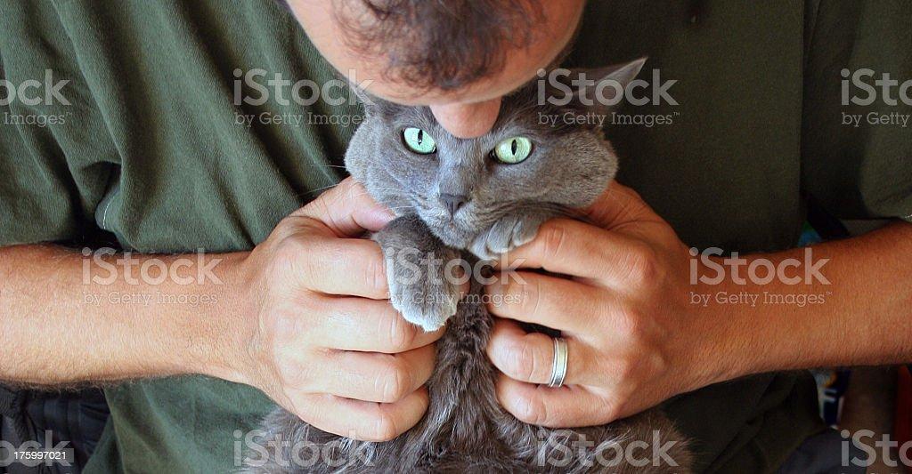 Smothering Propriétaire d'animal de compagnie photo libre de droits