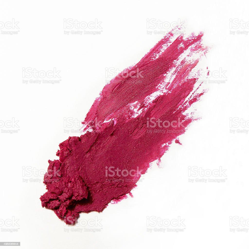 smudge fuchsia magenta lipstick on white background stock photo