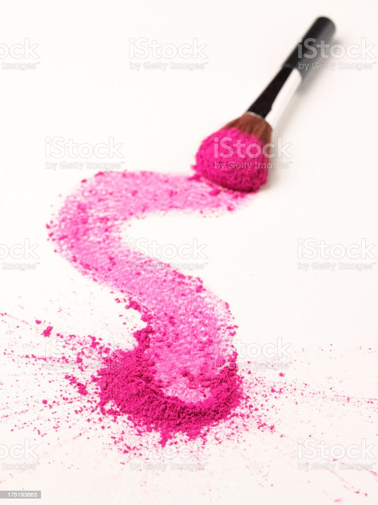 Smudge of Pink Eyeshadow on Paper and Brush stock photo