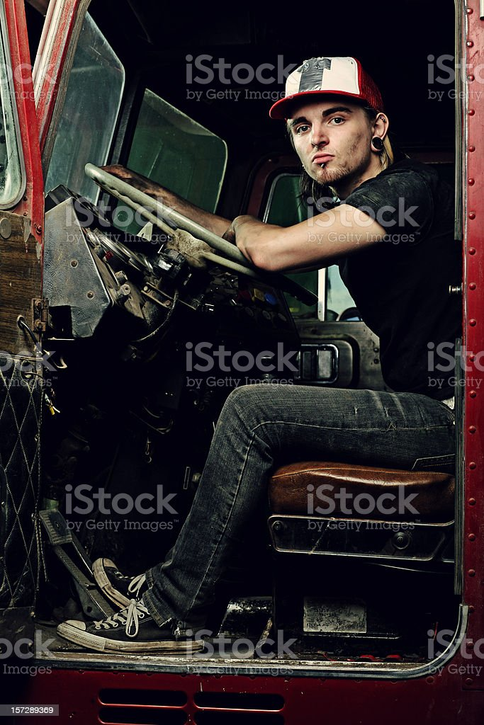 Smug Punk Guy Sitting in Old Truck stock photo