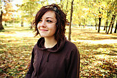 Smug Young Brunette Girl in the Park