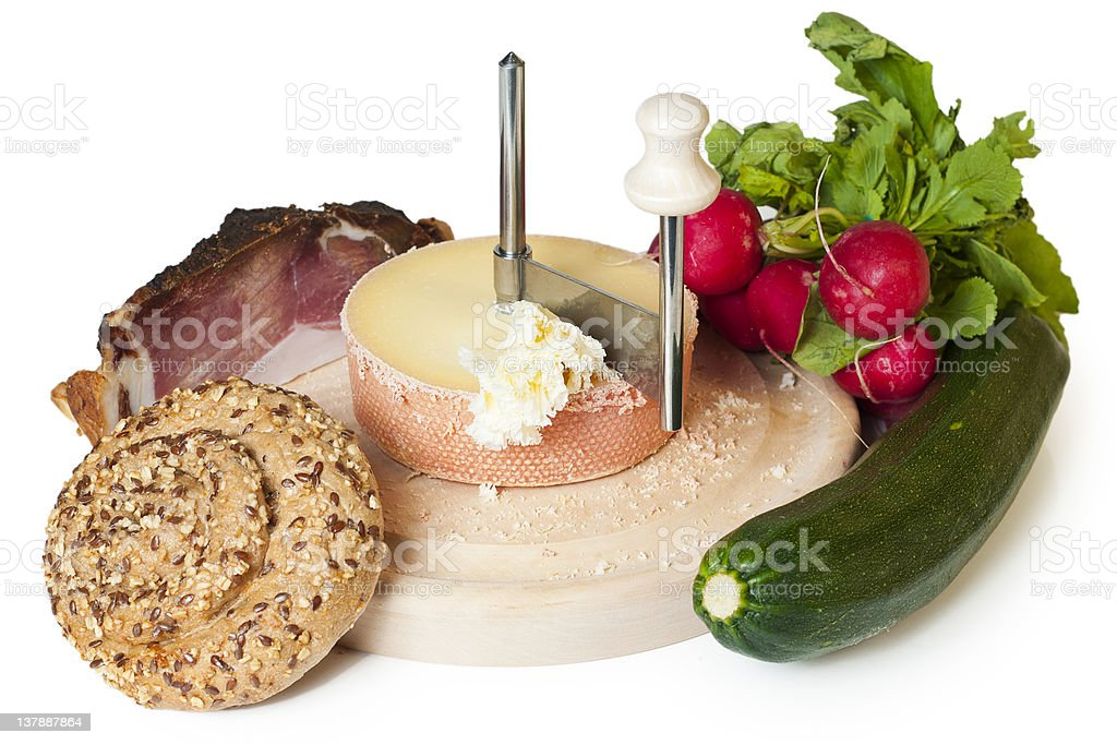 snack consisting of bread, cheese, bacon,  green squash and radish royalty-free stock photo