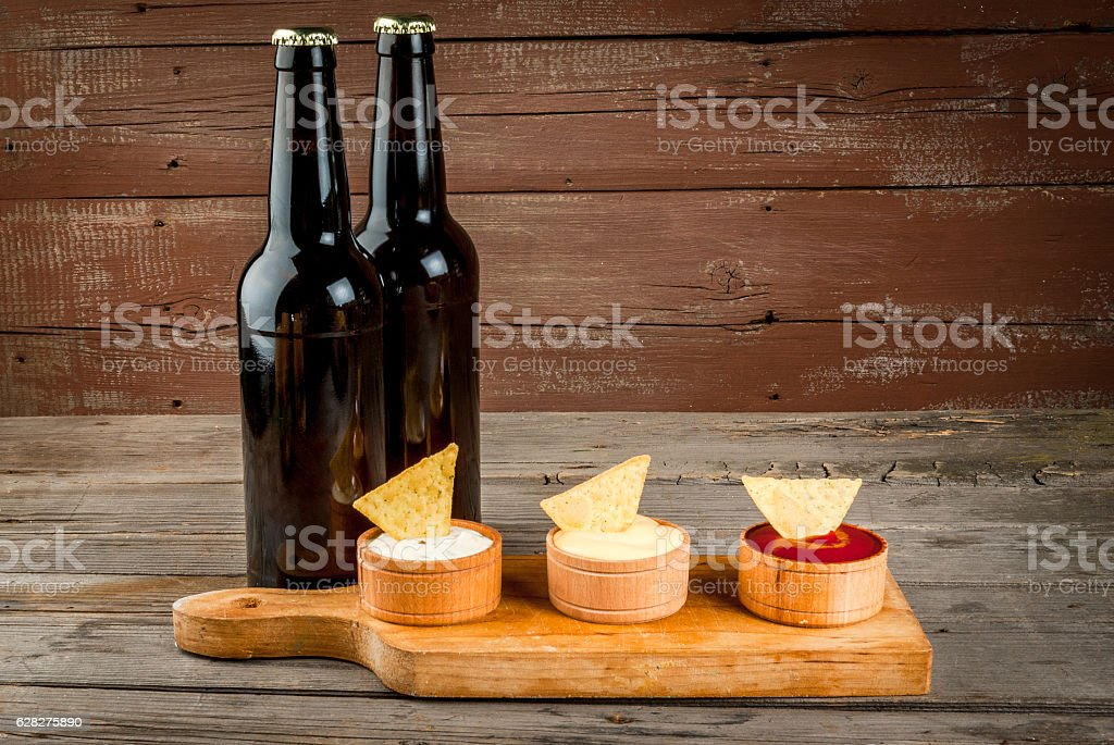 Snack for party, chips, nachos and beer stock photo