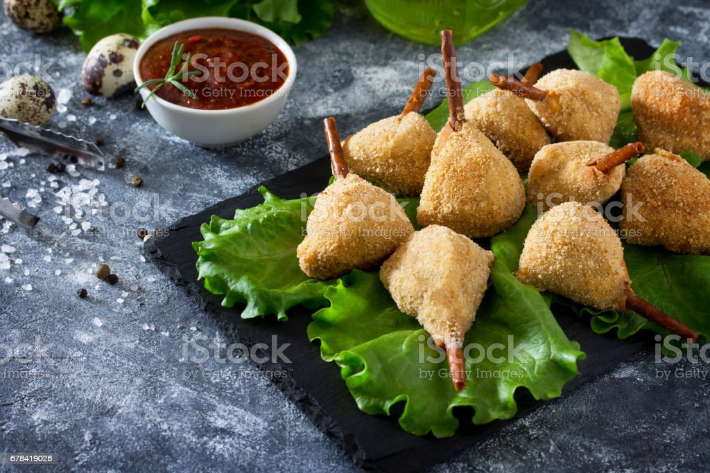 Snack spicy fried quail legs, cutlet in a batter with breaded on the kitchen table. Fast food. Copy space. stock photo