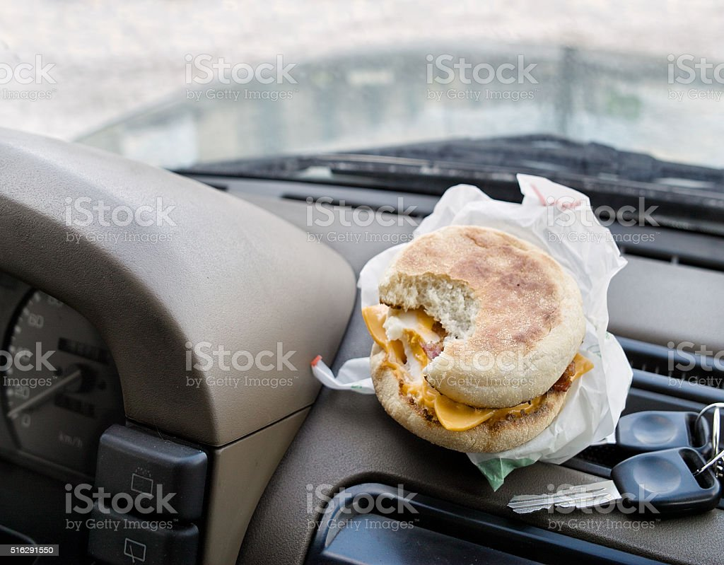 Snack While Driving stock photo