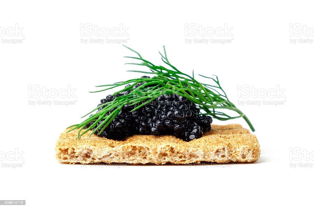 Snack with black caviar stock photo