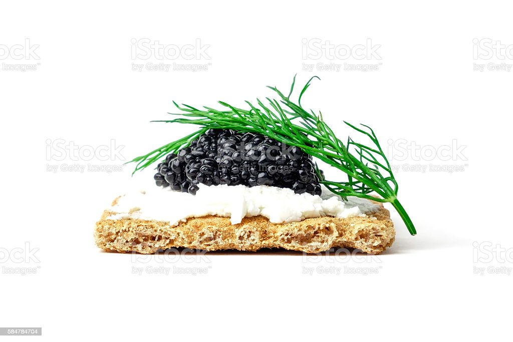 Snack with black caviar stock photo