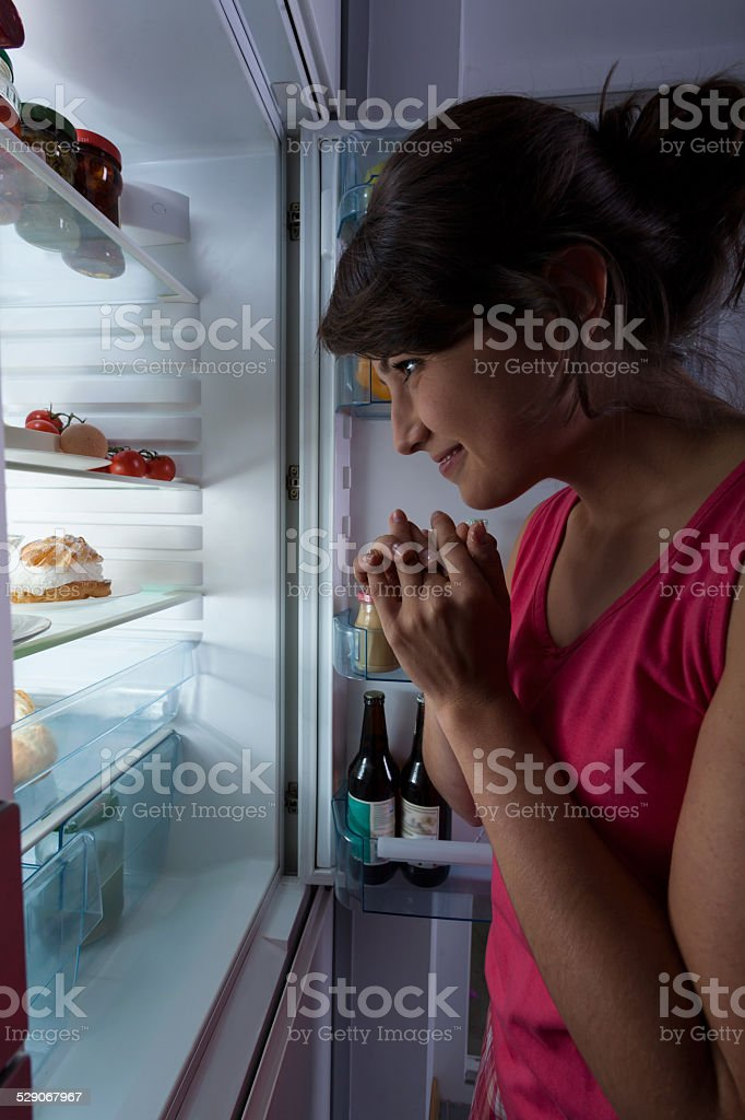 Snacking at midnight stock photo