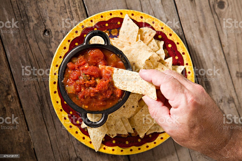 Snacking On Some Salsa And Chips stock photo