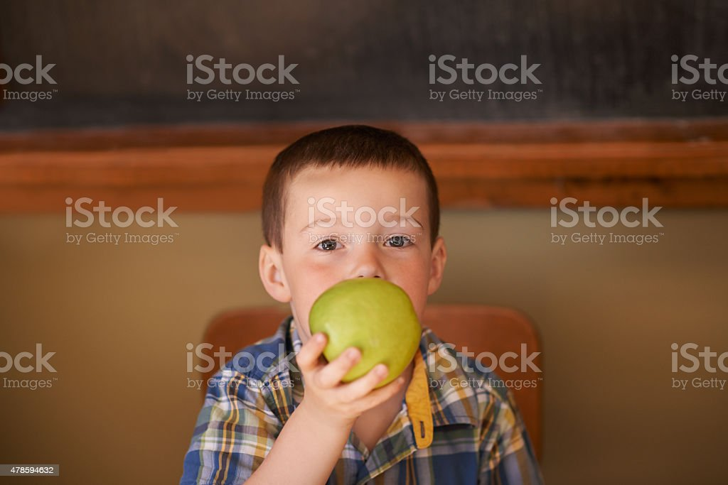 Snacking on sweet and crunchy apple stock photo
