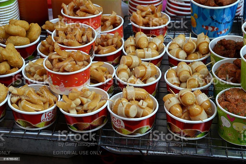 Snacks at food stall, Sunday market in Silom district, Bangkok stock photo