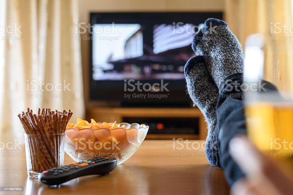 Snacks on the table while watching the television stock photo