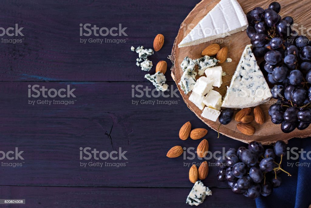 Snacks to wine. Grapes, cheese, nuts, olives. stock photo