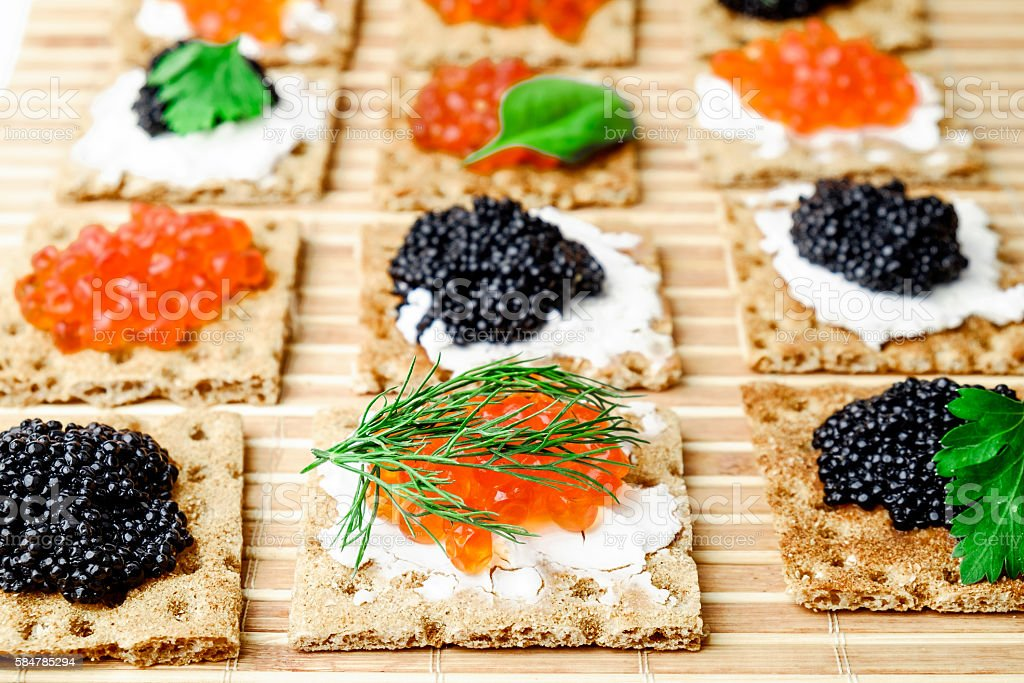 Snacks with caviar stock photo