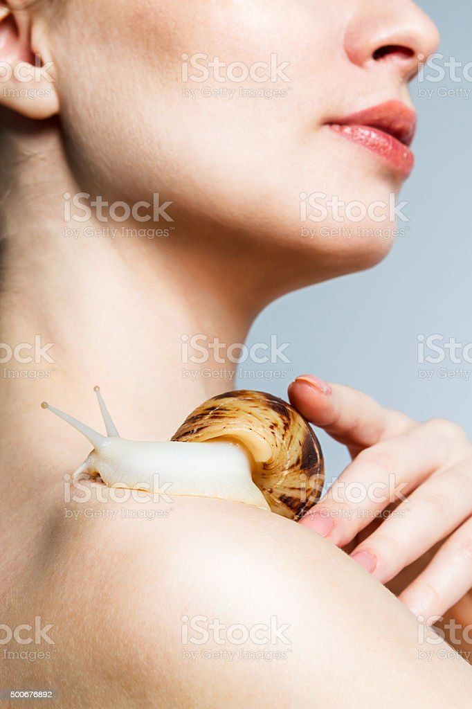 Snail on the shoulder. royalty-free stock photo