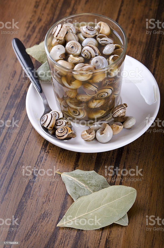 Snails on glass and laurel leafs royalty-free stock photo